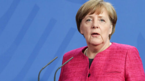 Climate change fight can't wait for doubters, says Angela Merkel