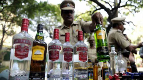 Three liquor smugglers held, red-beacon car seized