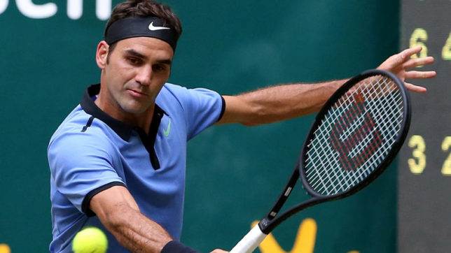 Wimbledon: Roger Federer smashes his way into third round