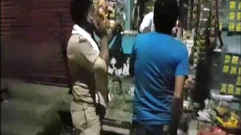 WATCH: 'Drunk' on duty; cop asks prisoner to buy tobacco in Etah, Uttar Pardesh
