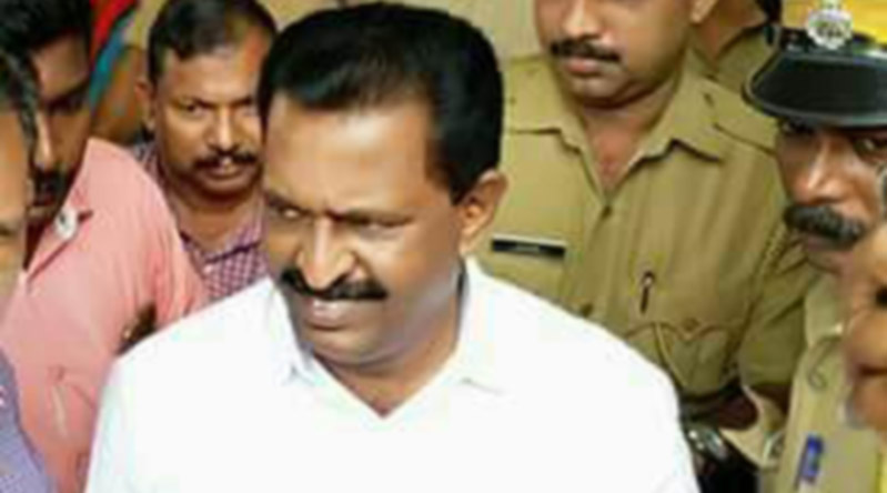 Thiruvananthapuram: Kerala Congress legislator M Vincent, who is arrested on the charges of sexual harassment and stalking of a 51-year-old woman who attempted suicide being take away by police in Thiruvananthapuram on July 22, 2017. (Photo: IANS)