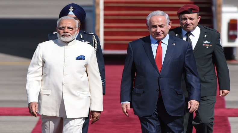 TEL AVIV, July 4, 2017 (Xinhua) -- Israeli Prime Minister Benjamin Netanyahu (R, Front) welcomes Indian Prime Minister Narendra Modi (L, Front) at Ben Gurion International Airport outside Tel Aviv, Israel, on July 4, 2017. Indian Prime Minister Narendra Modi landed in Israel Tuesday for the first-ever visit of an Indian prime minister to the country, in bid to boost all-round ties. (Xinhua/JINI/IANS)