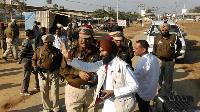 Jalandhar: Policemen outside self styled godman Ashutosh Maharaj's - who is in deep freeze since January and has been declared clinically dead - Divya Jyoti Jagriti Sansthan in Nurmahal, Jalandhar, on Dec 3, 2014.  The private security of the sansthan has stepped up its vigil after court has ordered cremation of the godman. (Photo: IANS)