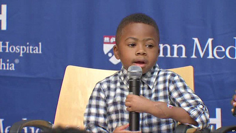Kid with world's first double hand transplant now plays baseball