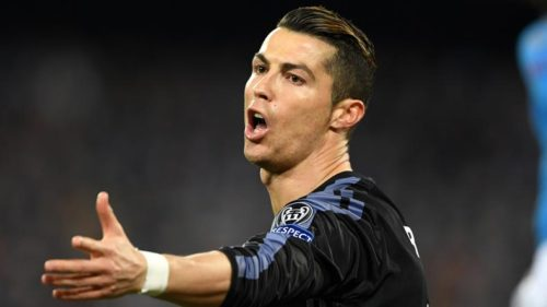 Real-Madrid's-Cristiano-Ronaldo-reacts-during-the-Champions-League-round-of-16