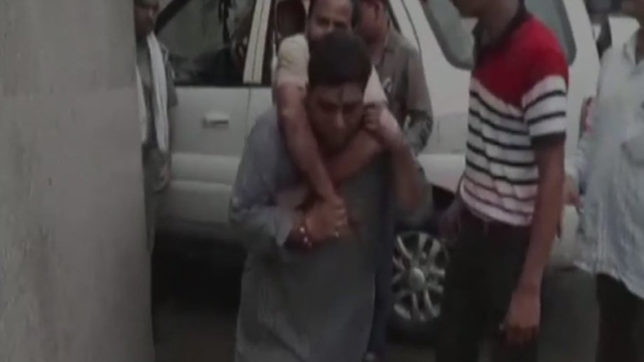 Farrukhabad: MLA carries accident victim on his back