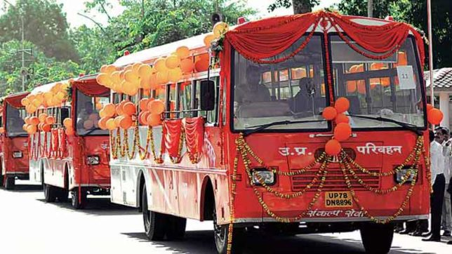 UP CM Yogi Adityanath flags-off saffron buses in the state