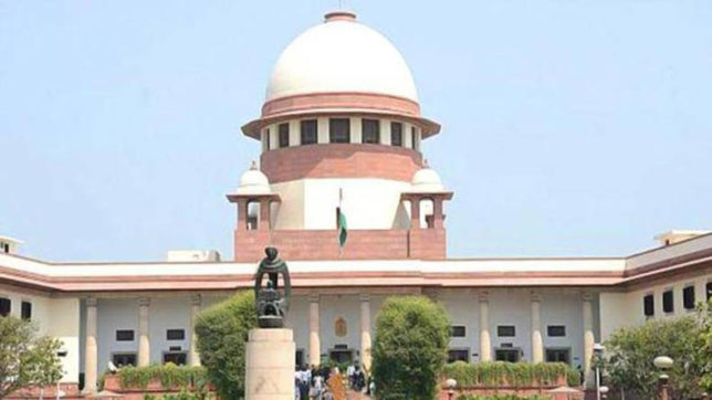 Supreme Court seeks Centre's response on pleas challenging Aadhaar Act; asks banks, telecom firms to not create panic