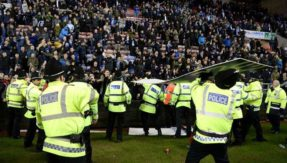 FA charges Manchester City and Wigan; spares Sergio Aguero for his altercation with fan