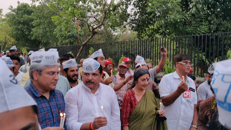 Delhi statehood issue: AAP intensifies protest against L-G Anil Baijal, launches candle march