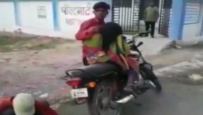 Man carries dead mother on bike