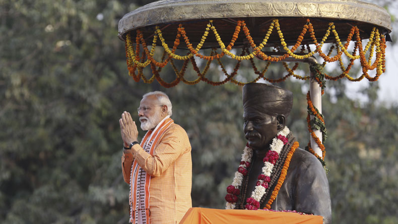 Indian Prime Minister Narendra Modi greets the crowd as he stands in front of a statue of freedom fighter Madan Mohan Malviya at Banaras Hindu University in Varanasi, India, Thursday, April 25, 2019. The ongoing general election is seen as a referendum on Modi's five-year rule. He has adopted a nationalist pitch in trying to win votes from the country's Hindu majority by projecting a tough stance against Pakistan, India's Muslim-majority neighbor and archrival. (AP Photo/Rajesh Kumar Singh)
